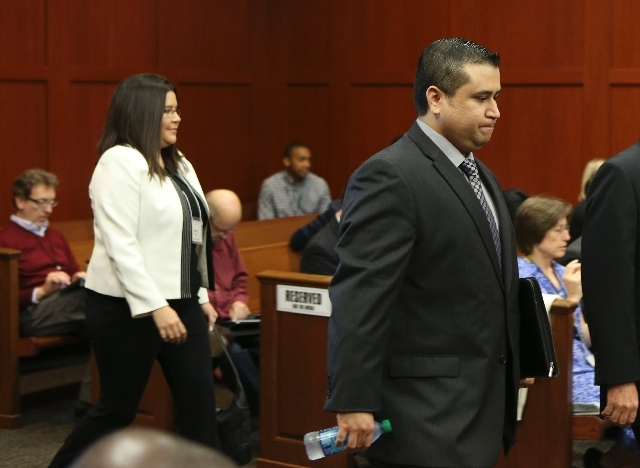 George Zimmerman enters the courtroom for his trial in Seminole circuit court in Sanford, Fla. Wednesday. Zimmerman has been charged with second-degree murder for the 2012 shooting death of Trayvo ...