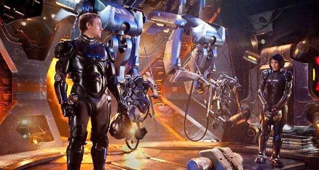 """Raleigh Becket (Charlie Hunnam) and Mako Mori (Rinko Kikuchi) team up to battle giant monsters known as Kaiju in Guillermo del Toro's """"Pacific Rim."""""""