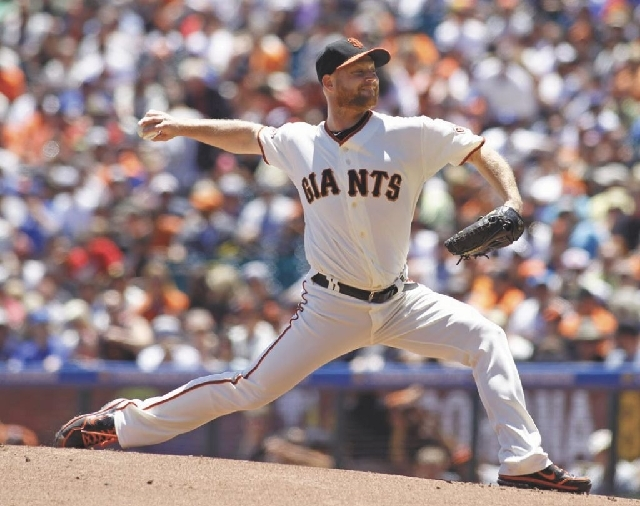 San Francisco Giants pitcher Chad Gaudin, shown pitching in the Giants' game Sunday against the Los Angeles Dodgers, was charged by the Clark County District Attorney's office with open and gross  ...