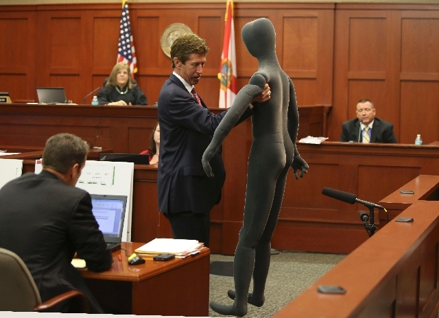 Defense attorney Mark O'Mara, standing center, uses a foam dummy to describe the altercation between George Zimmerman and Trayvon Martin to defense witness and law enforcement expert Dennis Root,  ...