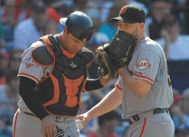 San Francisco Giants pitcher Chad Gaudin, right, and catcher Guillermo Quiroz talk during a game against the Atlanta Braves in June at Turner Field in Atlanta. Gaudin has been charged in Las Vegas ...