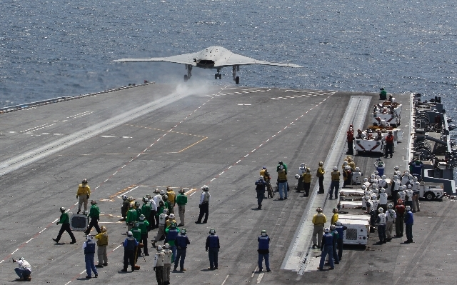 A X47-B Navy drone is launched off the deck of the nuclear aircraft carrier USS George H. W. Bush off the Coast of Virginia Wednesday. It is the first landing by a drone on a Navy carrier.  The la ...
