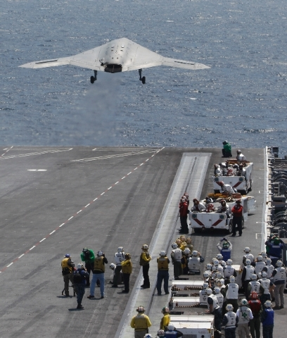 A X47-B Navy Drone is launched from the deck of the nuclear aircraft carrier USS George H. W. Bush off the Coast of Virginia Wednesday. It is the first landing by a drone on a Navy carrier.  The l ...
