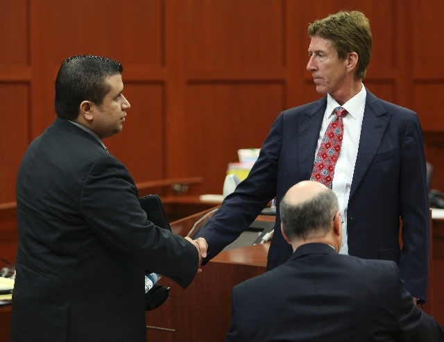George Zimmerman, left, shakes hands with his defense attorney Mark O'Mara during a recess in his trial in Seminole circuit court in Sanford, Fla. Wednesday. Zimmerman has been charged with second ...