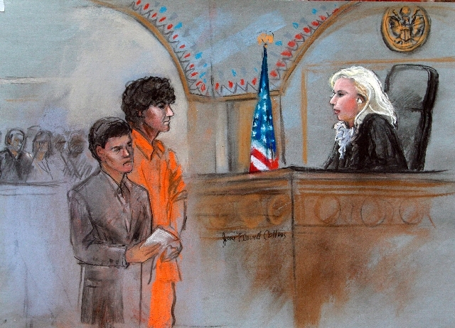 This courtroom sketch depicts Boston Marathon bombing suspect Dzhokhar Tsarnaev standing with his lawyer Miriam Conrad, left, before Magistrate Judge Marianne Bowler, right, during his arraignment ...
