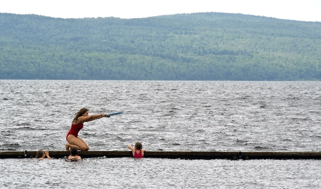 Instructor Laurence Perinet leads her swimming class in a lake near the site of where a runaway train derailed in Lac-Megantic, Que., on Thursday. Swimming is now allowed in the lake following wat ...