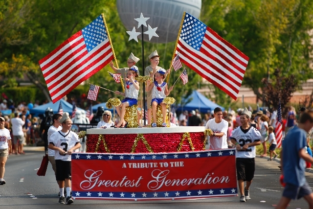 """A float representing """"A Tribute to the Greatest Generation"""" is seen during the Summerlin Council Patriotic Parade, July 4."""