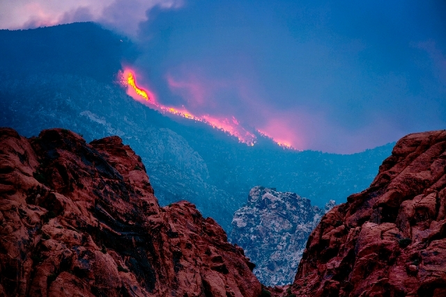 Smoke from the Carpenter 1 Fire is seen July 10 on the Red Rock Canyon road and Calico Basin.The lighting-caused fire, which started on July 1, has burned 28,000 acres.