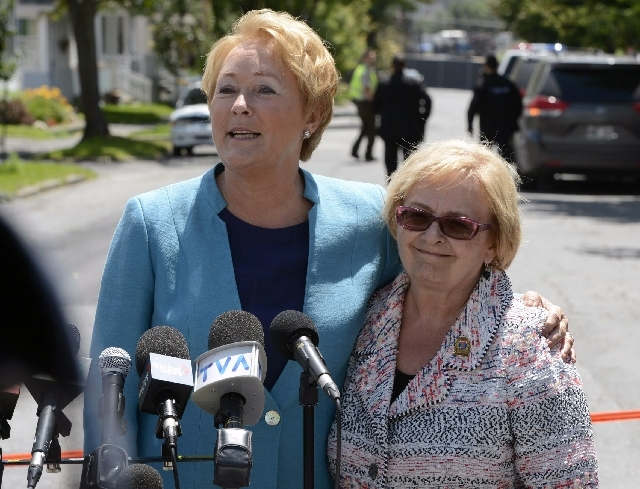 Quebec Premier Pauline Marois, right, and Mayor Colette Roy-Laroche speak during a news conference Thursday in Lac-Megantic, Quebec. Marois toured the site of Canada's worst railway catastrophe in ...