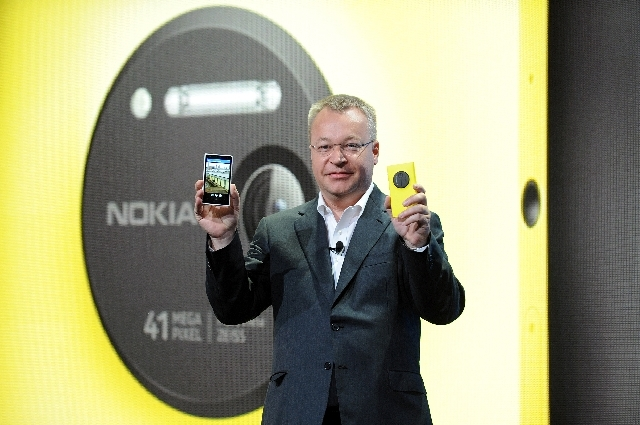 Nokia president and CEO Stephen Elop unveils the new Nokia Lumia 1020 smartphone, with a 41-megapixel camera, during a press event in New York Thursday.