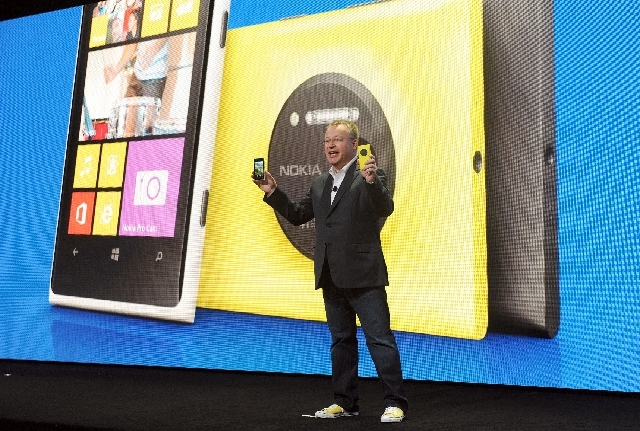 IMAGE DISTRIBUTED FOR NOKIA -Nokia president and CEO Stephen Elop unveils the new Nokia Lumia 1020 smartphone, with a 41-megapixel camera, during a press event in New York Thursday.