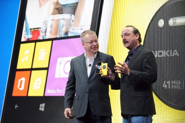 Nokia president and CEO Stephen Elop, left, and AT&T Mobility president and CEO Ralph de la Vega announce that AT&T will be the exclusive U.S. service provider for the Nokia Lumia 1020 during the  ...