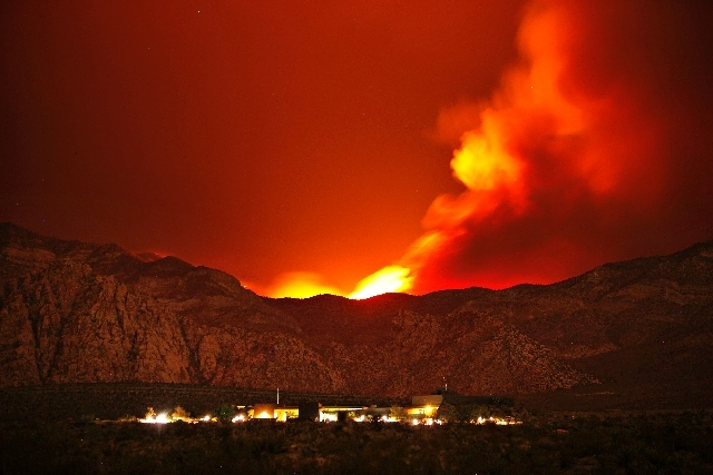 The Carpenter 1 Fire burns in the mountains behind the Red Rock Conservation Area visitor center near Las Vegas early in the morning of Thursday.