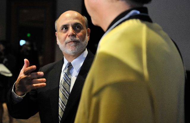 Federal Reserve Board Chairman Ben Bernanke, speaks with Jeffrey Frankel of the Kennedy School of Government, Harvard University after Bernanke addressed the National Bureau of Economic Research,  ...