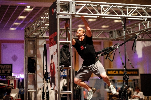 Neal Hamilton demonstrates the 4D Pro Reaction Trainer at the National Strength and Conditioning Association National Convention at Paris Las Vegas on July 11. The NSCA, founded by Boyd Epley in L ...