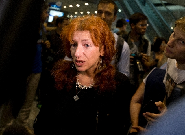 Deputy head of the Russian office of Human Rights Watch, Tatiana Lokshina, speaks to the media at Sheremetyevo airport outside Moscow, Russia, Friday.