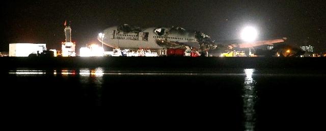 Asiana flight 214 is dismantled and hauled to a hangar at San Francisco International Airport in San Francisco, Calif., on Friday.