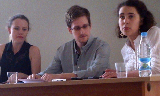 This image shows NSA leaker, Edward Snowden, centre, attending a press conference at Moscow's Sheremetyevo Airport with Sarah Harrison of WikiLeaks, left,  Friday. Snowden wants to seek asylum in  ...