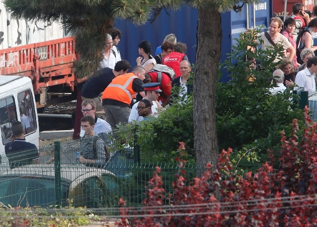 A train carrying hundreds of passengers derailed and crashed into a station outside Paris on Friday on the eve of a major holiday weekend. At least six people were killed and dozens were injured,  ...