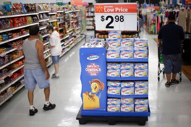 Shoppers pass by boxes of Twinkies at Wal-Mart, Friday in Bristol, Pa. The world's largest retailer announced Friday that that they are making Twinkies available this weekend, even though Hostess  ...