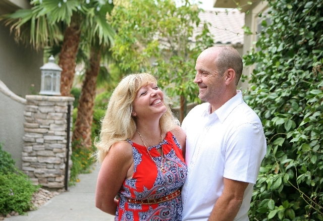 Kelly Keith and her husband Simon hug outside their home. He is now the chief operating officer of Nevada Donor Network.