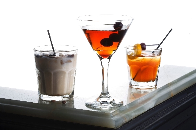 Alcoholic beverages derived from rye at The Lady Silvia bar include, from left, the Western Russian, the Twisted Manhattan and the Old-Fashioned.