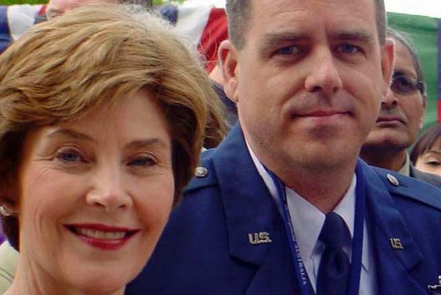 Lt. Col. Tim Ferner, right, appears with former First Lady Laura Bush in 2006 when Bush was visiting the Australian Embassy in Camberra.  Lt Col Ferner was a visiting Fellow teaching at the Austra ...