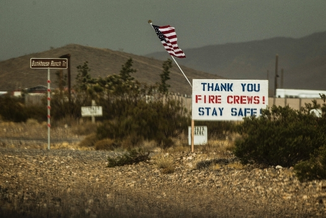 A sign as seen Friday on the Kyle Canyon Road. Over 1,000 personnel are fighting the 28,000-acre blaze in the Spring Mountains National Recreation Area.