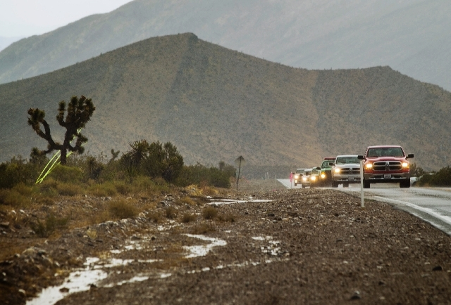 Fire vehicles head up  the Kyle Canyon Road on Friday. Flash flooding in the areas around Carpenter 1 Fire burn area have been reported.