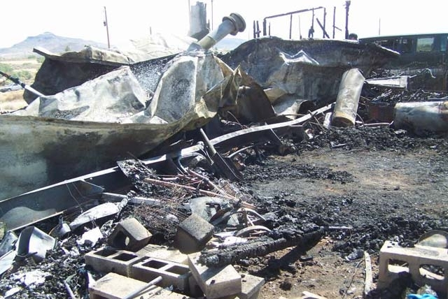 Fire destroyed a double-wide mobile home in north Kingman, Ariz., on Friday. Firefighters reponded to the scene and found the remains of Kimberly A. Sherwood, 57, near the rear door of the home.
