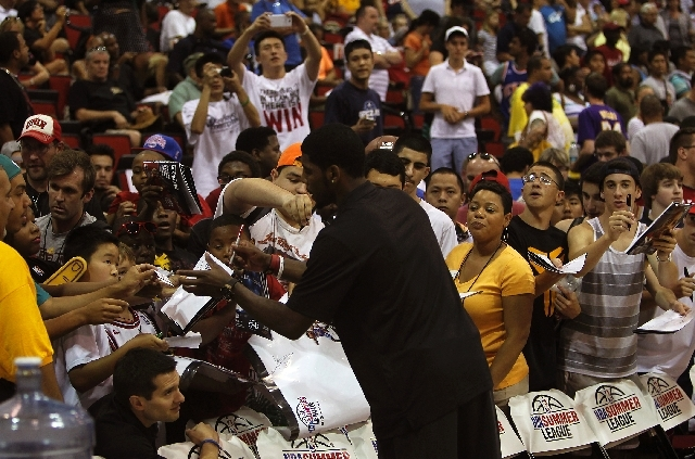 Fans flock to get Cleveland's Kyrie Irving's autograph during the NBA Summer League at the Cox Pavilion in Las Vegas on Friday.