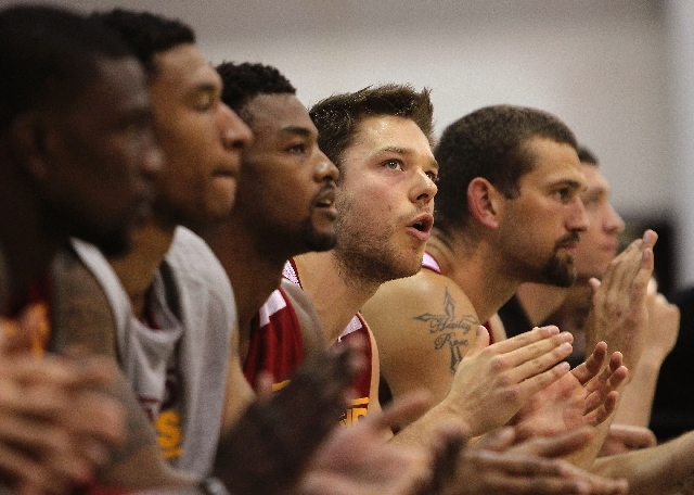 Cleveland's Matthew Dellavedova, fourth from left, cheers on his teammates against the Lakers during the NBA Summer League at the Cox Pavilion in Las Vegas on Friday.