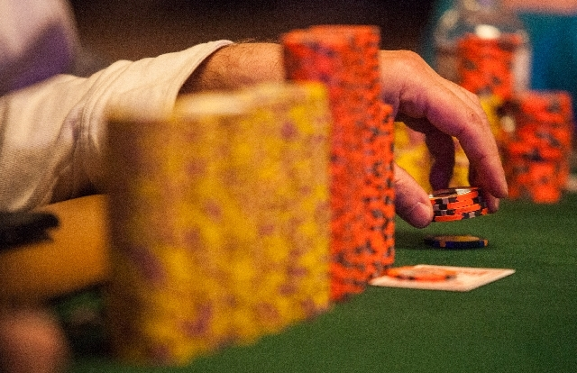 A poker player fiddles with chips during the fourth day of the World Series of Poker Main Event at the Rio Convention Center in Las Vegas on Friday.