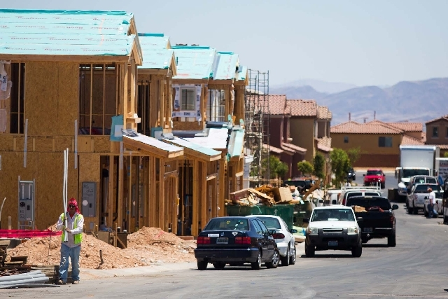 News houses are constructed by builder Lennar Homes in the Mountains Edge subdivision Monday, June 17, 2013. The National Association of Home Builders/Wells Fargo builder sentiment index released  ...
