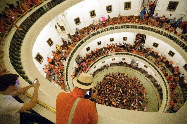 Abortion rights advocates fill the rotunda of the State Capitol as the Senate nears the vote on Friday night. Texas senators were wrapping up debate on sweeping abortion restrictions Friday night  ...