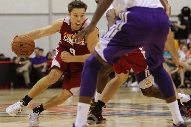 822e8ac9c03 Cleveland s Matthew Dellavedova (9) drives through the Lakers  defense  during the NBA Summer