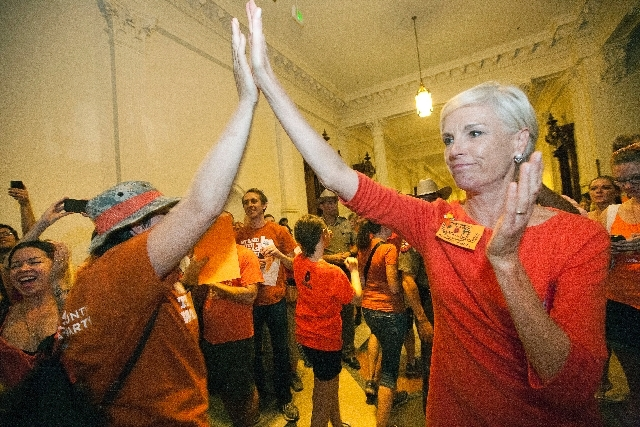 Cecile Richards, daughter of former Texas Gov. Ann Richards and President of Planned Parenthood Action Fund, greets abortion rights advocates as they leave the State Capitol rotunda in Austin, Tex ...