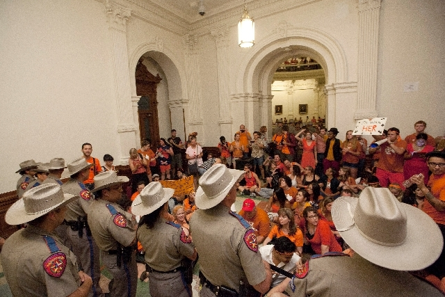 Abortion rights advocates protest HB2 from the area outside of the Senate Chamber in the State Capitol in Austin, Texas on Friday night.