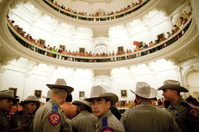 Texas State Troopers block the entrance to the State Capitol rotunda after abortion rights advocates filled it to capacity in Austin, Texas on Friday night.