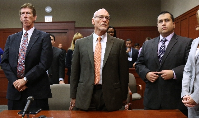 George Zimmerman, right, stands with his defense attorneys, Mark O'Mara, left, and Don West, as the jury arrives in the courtroom Saturday. Zimmerman was found not guilty in the 2012 shooting deat ...