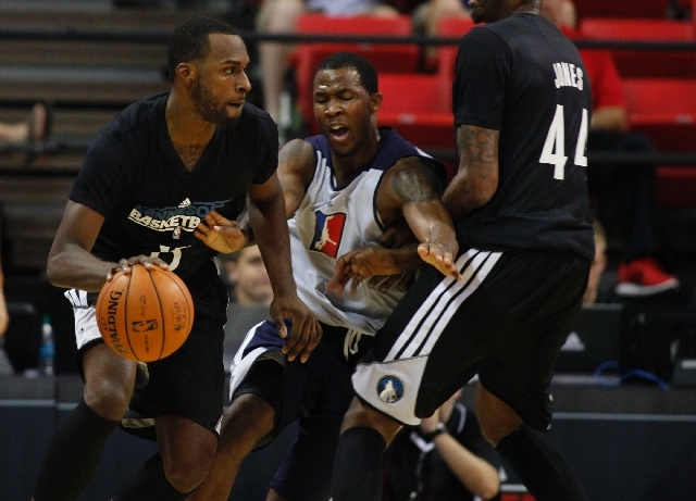 Shabazz Muhammad, left, of the Minnesota Timberwolves tries to dribble around Chris Johnson of the NBA D-League Select team during an NBA Summer League game Saturday at the Thomas & Mack Center. M ...