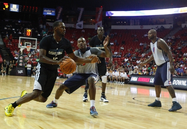 "Shabazz Muhammad, left, of the Timberwolves drives during his NBA Summer League debut against the NBA D-League Select team Saturday at the Thomas & Mack Center. ""I thought he did great. It was rea ..."