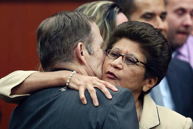 George Zimmerman's parents Robert Zimmerman Sr. and Gladys Zimmerman embrace following George Zimmerman's not guilty verdict in Seminole Circuit Court in Sanford, Fla., on Saturday.