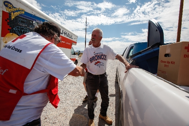 Trout Canyon resident David Mallory thanks Mike Ertel before heading home Sunday. Residents of Trout Canyon were allowed to return home after stopping by a checkpoint. The American Red Cross provi ...