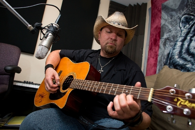 Erick Martin plays his guitar during a July 14 recording session. His uncle, also a musician, taught him about chord progression and basic songwriting.