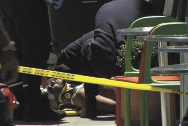 In this frame grab from video, emergency personnel tend to an injured man after a shooting outside a shopping center in San Francisco on Friday. Two women were killed and a man was wounded on Frid ...