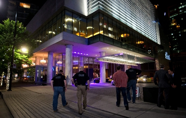 In this Saturday photo, police officers enter the Fairmont Pacific Rim Hotel where Canadian actor Cory Monteith was found dead in his room earlier in the day in Vancouver, British Columbia. Montei ...