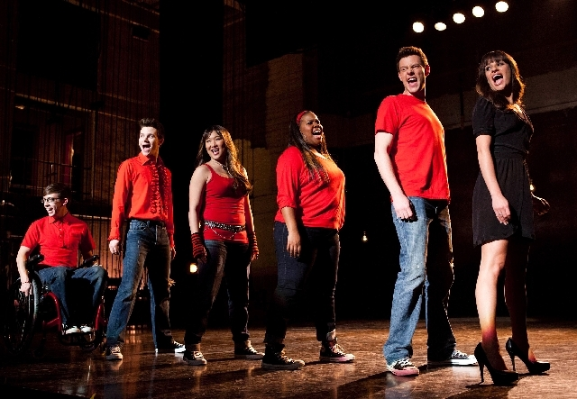 "In this undated image released by Fox, cast members, from left, Kevin McHale, Chris Colfer, Jenna Ushkowitz, Amber Riley, Cory Monteith and Lea Michele perform during a scene from ""Glee.""  Monteit ..."