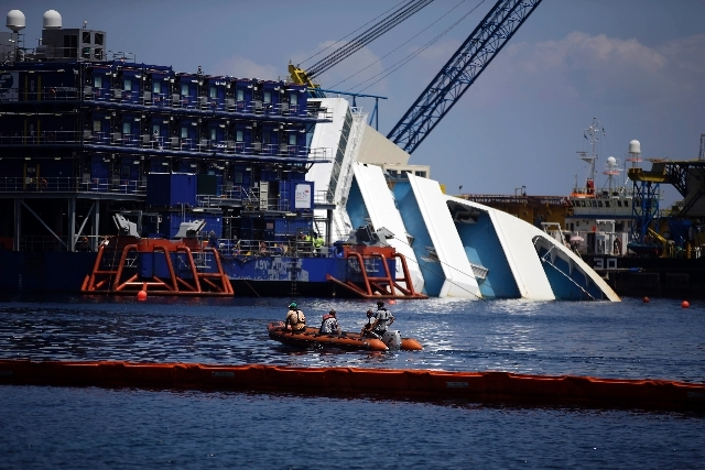 The Costa Concordia cruise ship lies on its side in the Tuscan Island of Isola del Giglio, Monday.