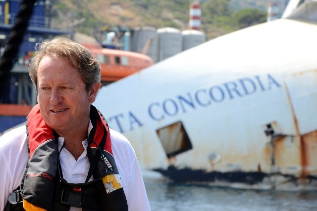 Senior salvage master Nick Sloane talks to journalists in front of the Costa Concordia Ship wreck in the Tuscan Island of Isola del Giglio Monday.